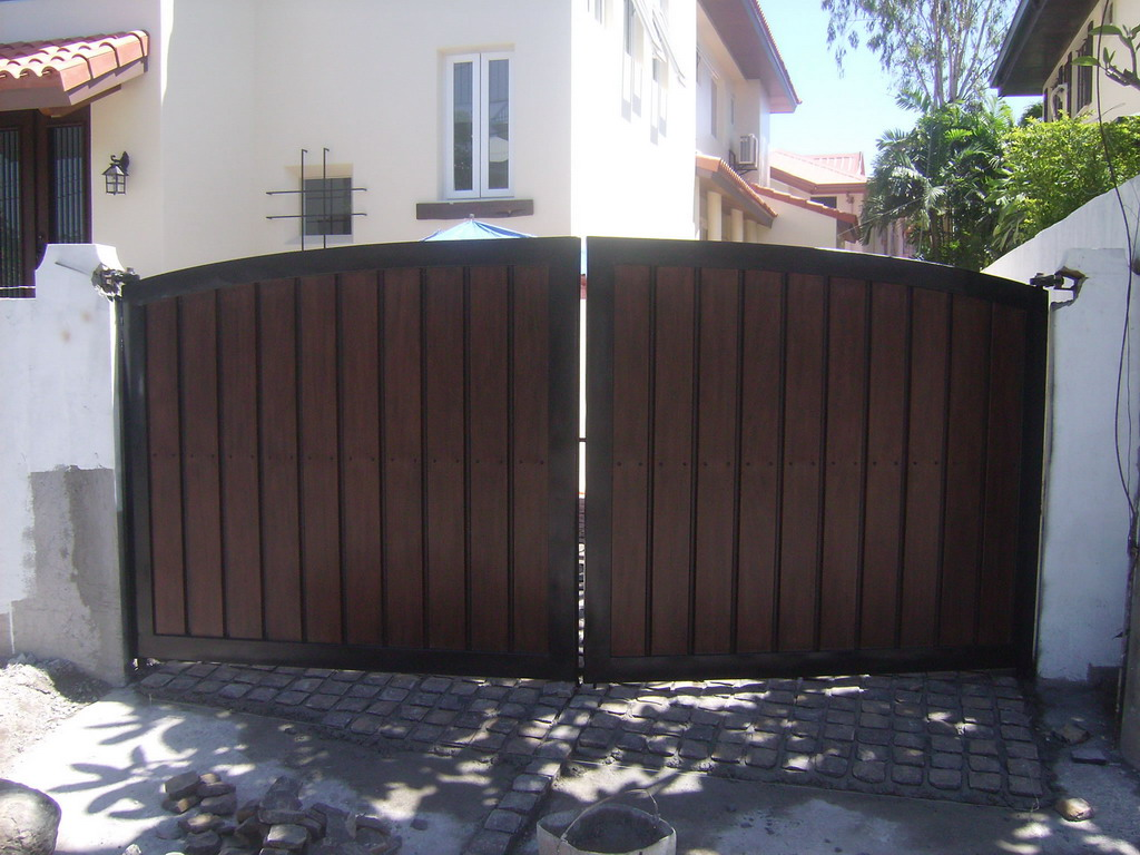 Vehicular Gate in G.I. Sheet Bended and in Wood Finish.