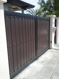 Gate in wood finish and wrought iron frame and studs accent.