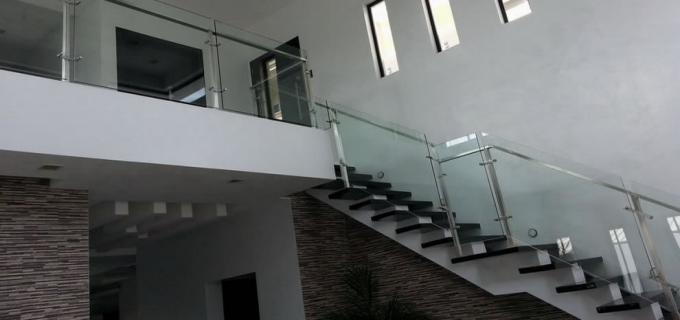 Frameless Glass Stair in Stainless Frame
